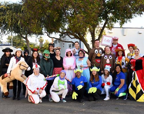Teachers dressed up in Halloween costumes